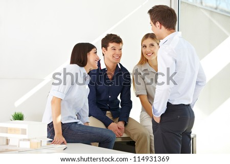 Happy young team having a meeting in the office - stock photo