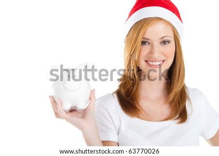 happy young teen girl holding a piggy bank over white - stock photo