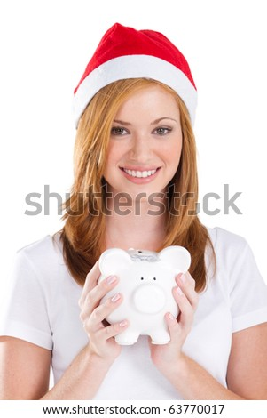 happy young teen girl holding a piggybank over white - stock photo