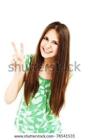 Happy young teenager girl showing victory sign - stock photo