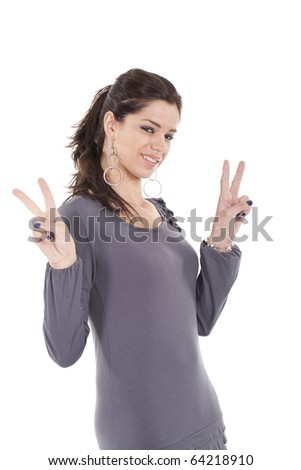 Happy young teenager girl showing victory sign with both hands isolated on white background