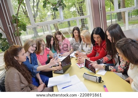 happy young teens group in school on chemisty lessons and library education - stock photo