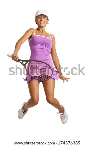 Happy young tennis player jumping into the air with a racket . isolated on white - stock photo