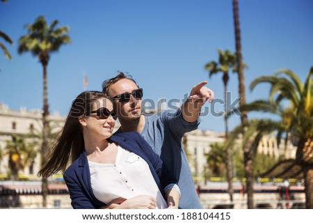 Happy young tourist couple is enjoying vacation in Barcelona, Spain. - stock photo