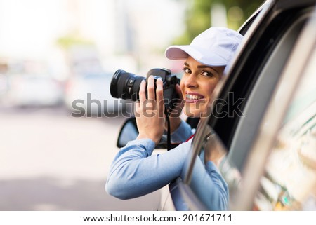 happy young tourist touring the city and holding a camera - stock photo