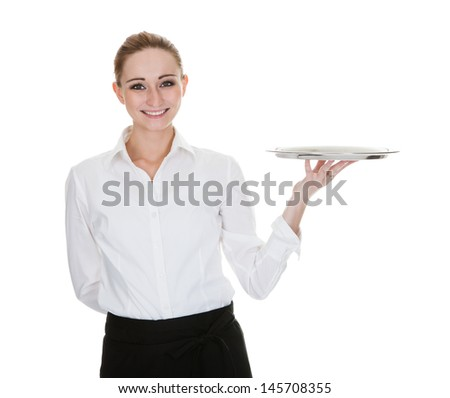 Happy Young Waitress Holding Tray Over White Background - stock photo