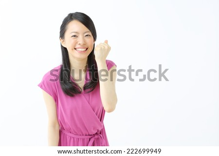happy young woman against white background - stock photo