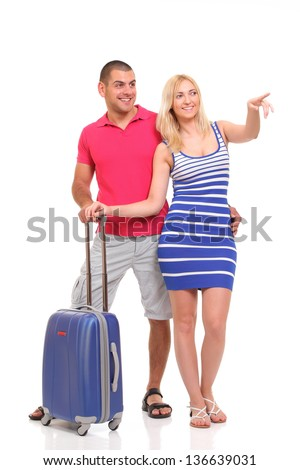 happy young woman and a man with a suitcase for travel - stock photo