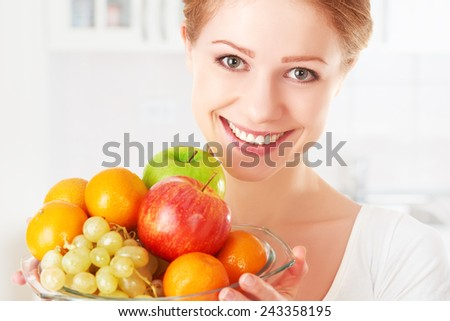 happy young woman and healthy vegetarian food, fruit - stock photo