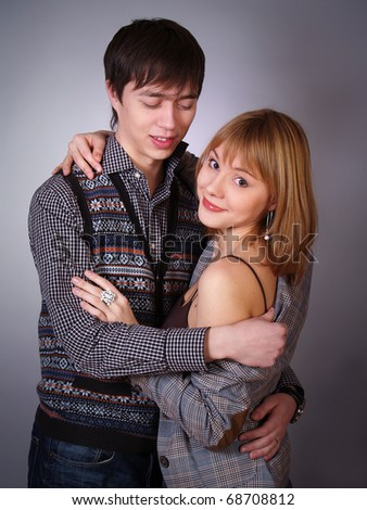 happy young woman and man in casual clothes smiling together - stock photo
