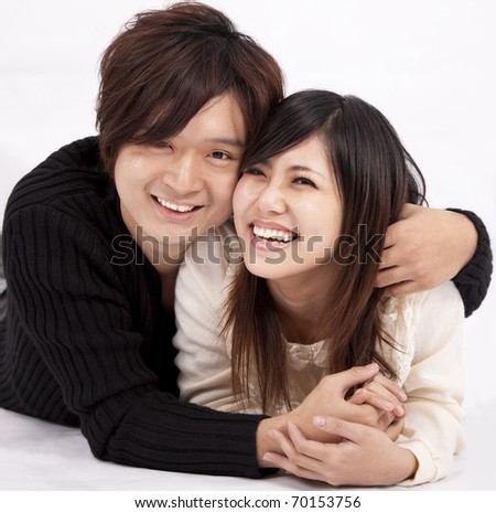 happy young woman and man smiling together - stock photo