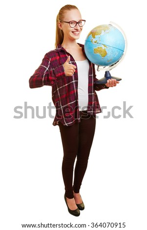 Happy young woman as teacher holding thumb up and carrying a globe - stock photo