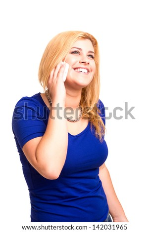 Happy young woman at cellphone, isolated over a white background - stock photo