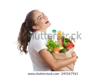 Happy Young Woman Carrying a Shopping Bag Full of Groceries at White Background