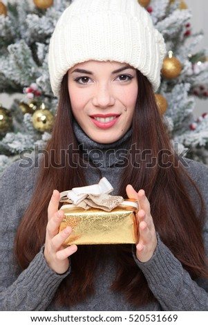 happy young woman celebrating Christmas at home