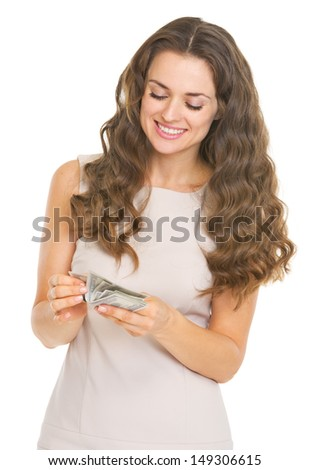 Happy young woman counting money - stock photo