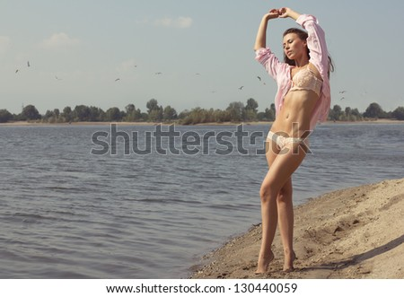 happy young woman dance in the beach