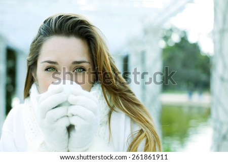 Happy young woman drinking tea - stock photo