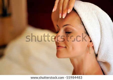 happy young woman during cosmetic treatment - stock photo