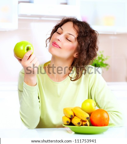Happy Young Woman Eating Apple.Diet.Dieting concept.Healthy Food. Vegetarian