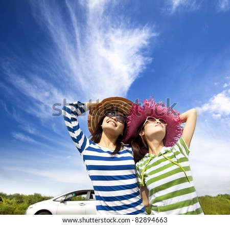 happy young woman enjoy vacation  on road trip - stock photo