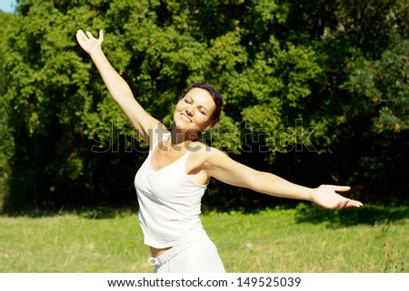 happy young woman enjoying a walk in the fresh air - stock photo