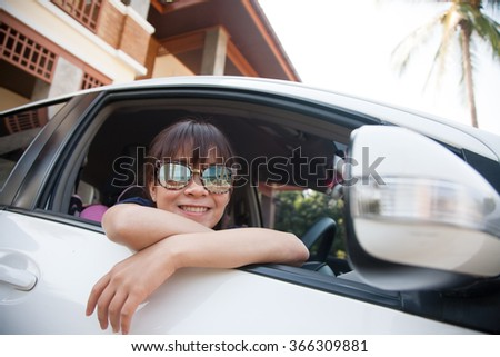 Happy Young woman enjoying freedom life in car at vacation home near the beach - stock photo