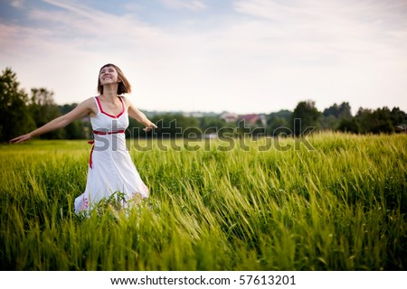 happy young woman enjoying nature - stock photo