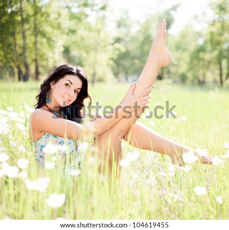 happy young  woman enjoying the sun outdoor on the grass on a summer day