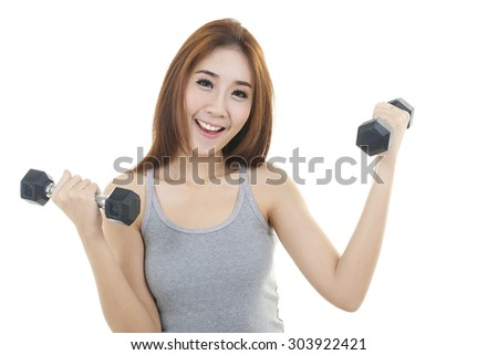 happy young woman exercising with dumbbells