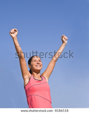 Happy young woman expressing the joy of winning.