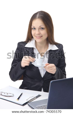 Happy young woman filling a business form while on her desk at work - stock photo