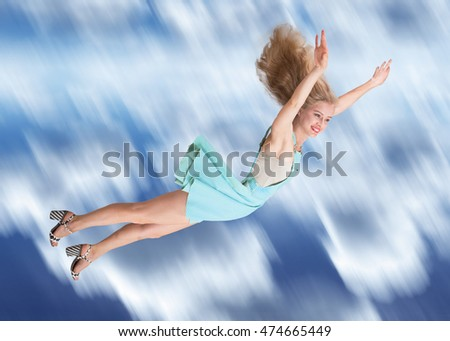 Happy young woman flying in the sky