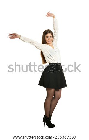 Happy young woman gesturing winner sign isolated on white background - stock photo