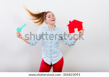 Happy young woman girl holding red paper house and key dreaming about new home house. Housing and real estate concept. - stock photo