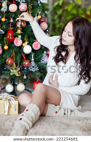Happy young woman giving christmas present box - stock photo