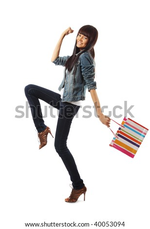 Happy young woman going shopping enthusiastically, isolated over white background. - stock photo