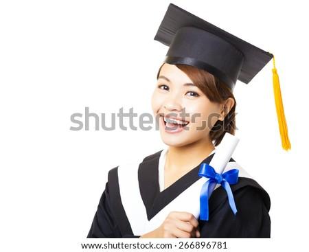 happy young woman graduating holding diploma - stock photo