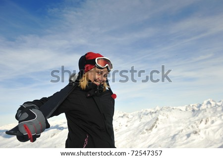 happy young woman have fan while relaxing at snow with ski and snowboard sport at winter seasonyoung athlete man have fun during skiing sport on hi mountain slopes at winter seasson and sunny day - stock photo