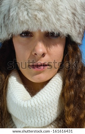 happy young woman having fun on winter vacation in beautiful nature landscape with fresh snow