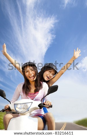 Happy young woman having summer trip on a scooter - stock photo
