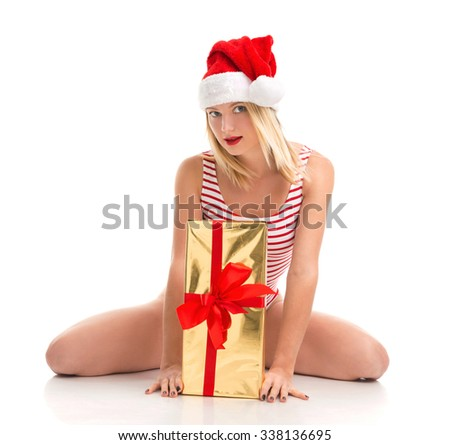 Happy young woman hold red Christmas wrapped gift present smiling surprised isolated on a white background
