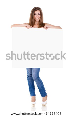 happy young woman holding a blank billboard - stock photo