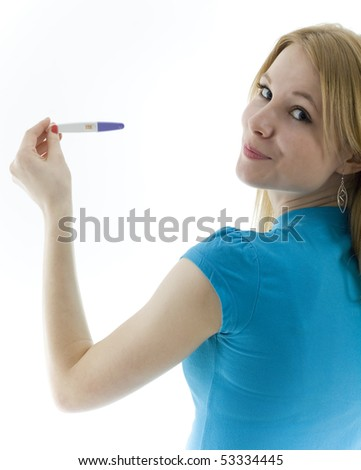 happy young woman holding a positive pregnancy test - stock photo