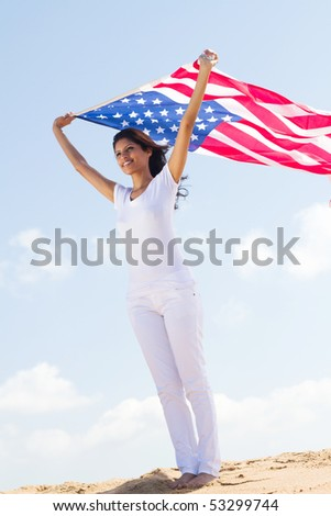 happy young woman holding american flag - stock photo