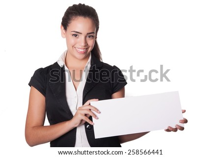 Happy young woman holding blank card - space for text, isolated on white
