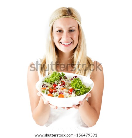 Happy young woman holding bowl with healthy fresh food .