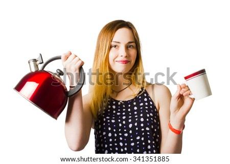 Happy young woman holding kettle and coffee cup when offering another cuppa over white background - stock photo