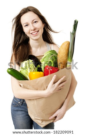 Happy Young Woman Holding Large Bag of Healthly Groceries - Stock Image/ Isolated on white