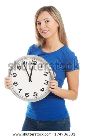 Happy young woman holding office clock - stock photo